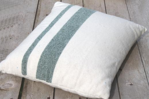 pair of vintage feather pillows w/ old wool camp blanket fabric covers