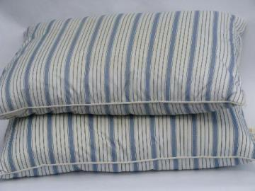 pair vintage feather pillows, blue striped cotton covers
