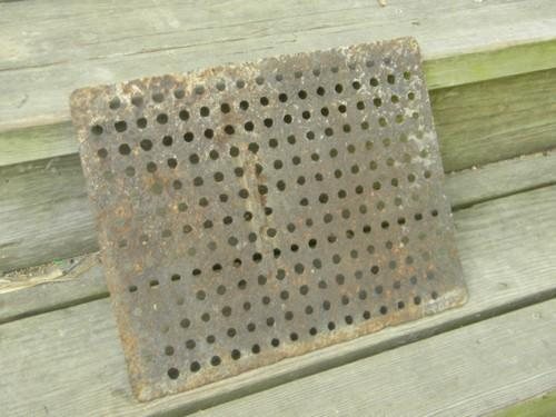 primitive antique cast iron floor grating or industrial drain cover