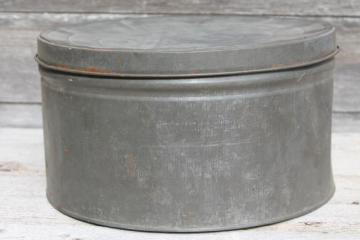primitive old antique metal cracker box or cake tin, large round hatbox shape