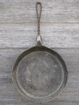 primitive old campfire or wood stove frying pan, skillet w/ wirework handle