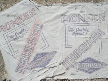 primitive old farm seed corn grain sacks, vintage Pioneer graphics