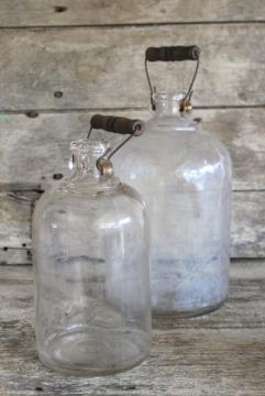 primitive old glass half & gallon bottles, moonshine jug jars w/ wire bail wood handles