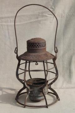 primitive rusty old railroad lantern, old iron lamp cage without glass shade