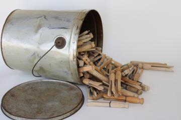 primitive tin bucket full of vintage hard wood clothespins, rustic farmhouse decor