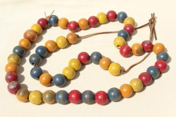 primitive vintage counting string, big round wood beads, wooden beads in primary colors