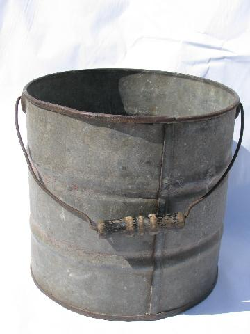 primitive vintage metal farm bucket, heavy wire / old wood handle