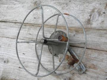 primitive vintage wire winding reel for garden hose, laundry line, rope