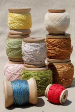 primitive wood spools of colored thread, vintage pearl cotton embroidery floss