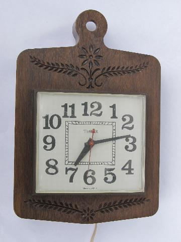 retro 70s vintage Timex kitchen wall clock, chip carved plastic frame