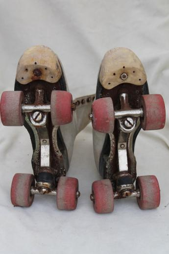 retro vintage roller skates w/ leather boots, very rough, great garden flower planters!