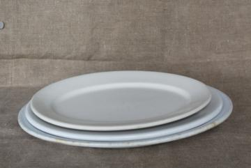rustic farmhouse kitchen old white ironstone china platters, graduated sizes stack