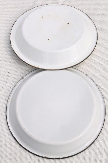 rustic vintage camp cookware - old white enamelware pans or pie plates
