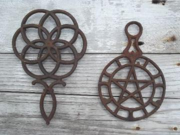 rusty vintage cast iron trivets, star in circle & large flower