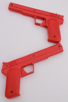 sci-fi style vintage red plastic rubber band shooters, toy guns pair of pistols