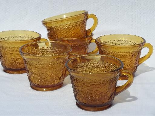 set 6 footed cups, vintage Tiara amber glass sandwich daisy pattern