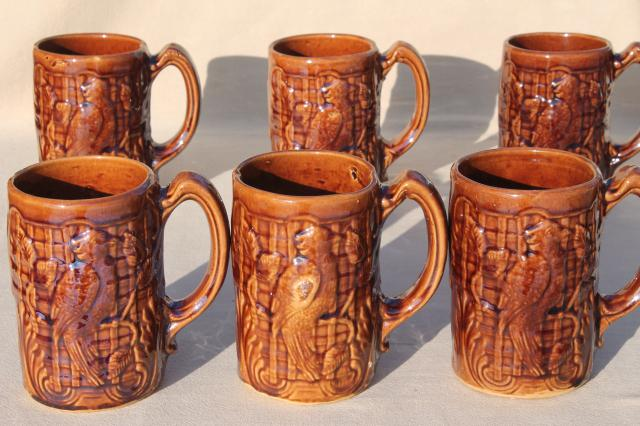 set of 6 vintage stoneware pottery mugs, tall cups or beer steins w/ parrot birds