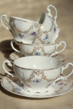 set of antique German bullion or cream soup bowls, double handled china cups w/ saucers