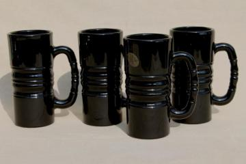 set of four opaque black glass mugs or steins w/ vintage Tiara glass labels