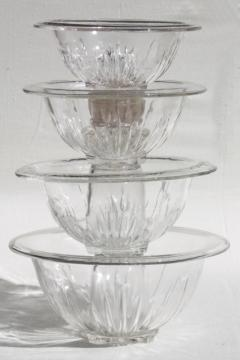 set of four vintage clear kitchen glass mixing bowls, nesting stack large to small sizes