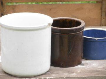 shabby old cracked stoneware crocks, plain, blue and brown for flower pots