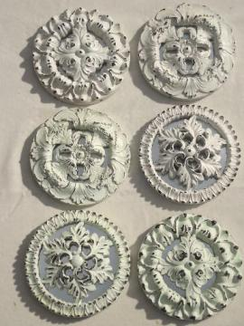 shabby white painted architectural molding ornaments, rosette medallions