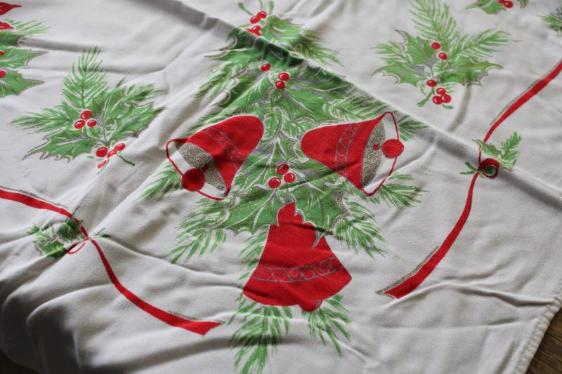 vintage Christmas print tablecloth, rayon fabric w/ bells, candles, holly, poinsettias