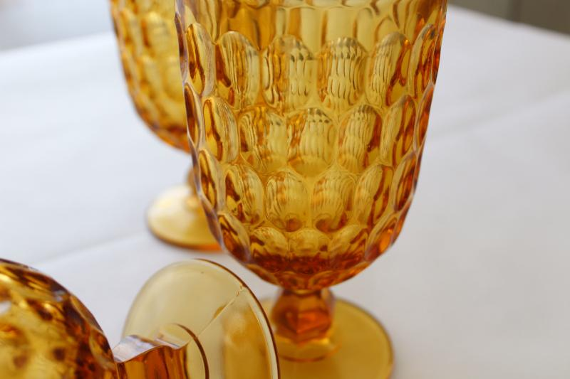 vintage Fenton thumbprint pattern glass water goblets, amber glass footed tumblers