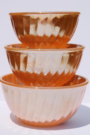 vintage Fire-King peach luster glass mixing bowl nest, nesting swirl bowls
