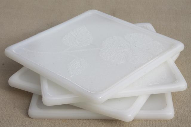vintage Glasbake milk glass trivet tiles with flowers, set of heat proof glass trivets