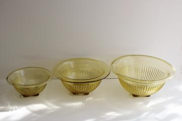 vintage Hazel Atlas glass nest of mixing bowls, amber yellow depression glass