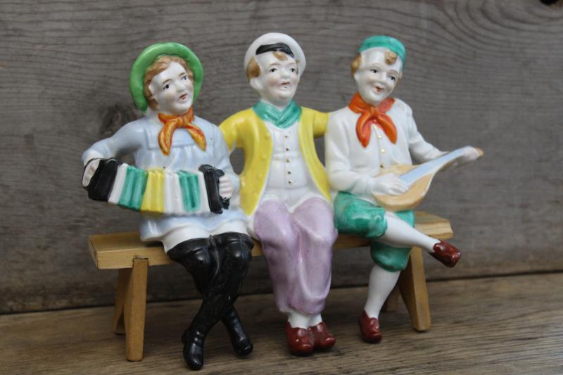 vintage Made in Japan hand painted figurine, jolly sailors band shelf sitter w/ wood bench