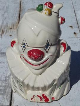 vintage McCoy pottery cookie jar, white glaze clown w/ handpainted face