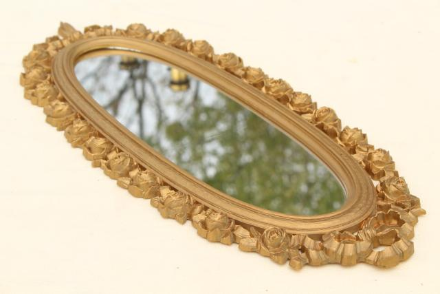 vintage Syroco gold plastic wall mirror, wreath of roses oval frame
