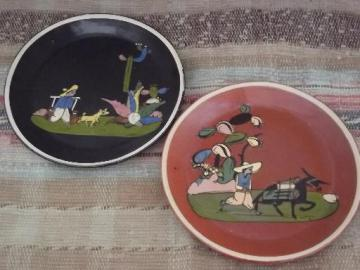 vintage Tlaquepaque Mexican painted pottery plates, one black, one red