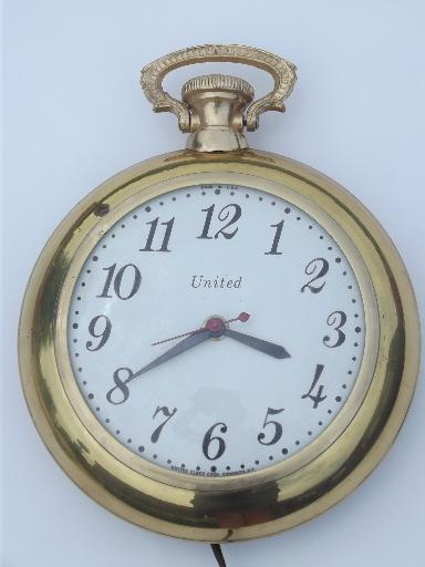vintage United electric pocket watch wall clock, metal w/ convex glass