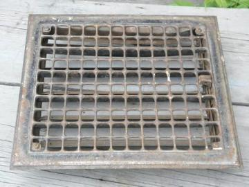 vintage architectural iron hardware, old floor or wall register grate