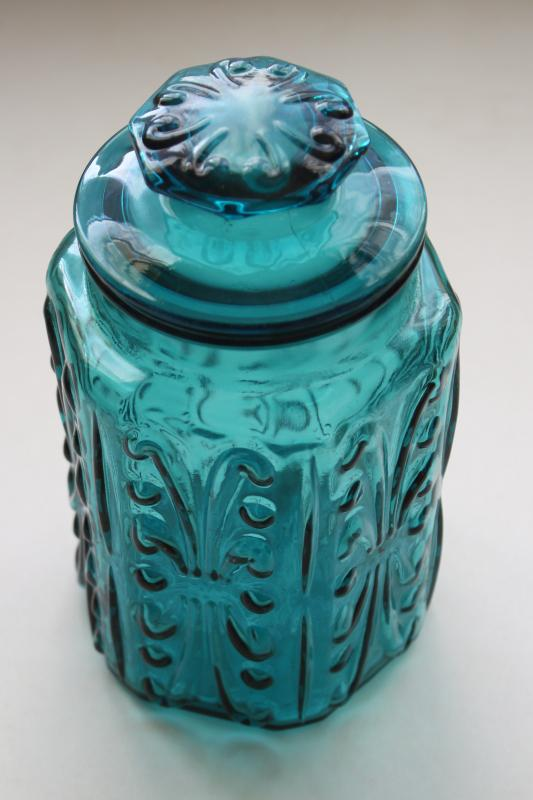vintage blue glass canister jar, scroll pattern aqua or teal colored glass