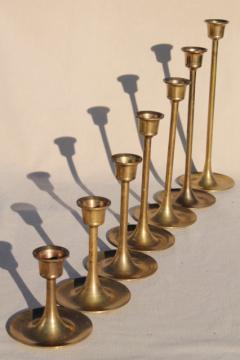 vintage brass candlesticks set in graduated heights, minimalist mod candle holders