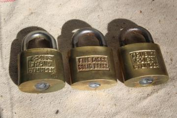 vintage brass padlocks, old five disc cylinder locks Fraim & Trubilt