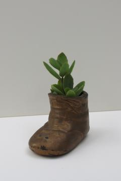 vintage brass plated baby shoe planter, heavy cast metal paperweight