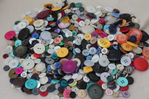 vintage buttons collection, old glass barrel jar full of buttons of all kinds