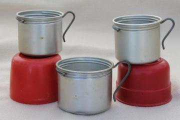 vintage camping cups, red bakelite or early plastic Aladdin thermos caps & aluminum mugs