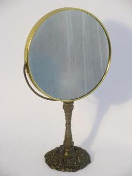 vintage cast metal magnifying shaving or vanity mirror on stand, antique brass finish