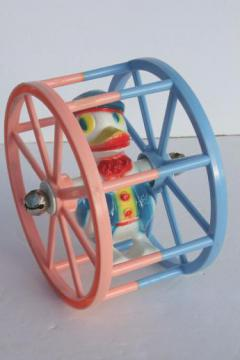 vintage celluloid plastic baby toy, sailor duck spinner wheel rolling push toy