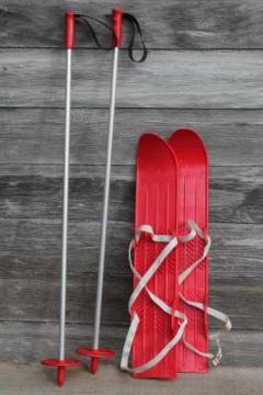 vintage child's size skis, red plastic mini-ski set w/ poles, winter sport toy