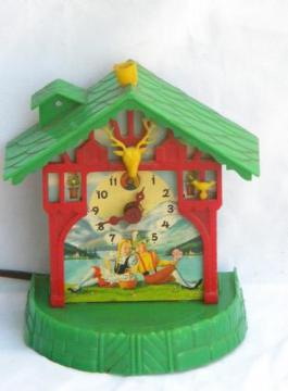 vintage child's swiss chalet electric clock w/litho Heidi graphics