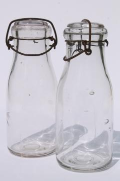 vintage cream or milk bottles, old half-pint bottle w/ wire bail glass lids
