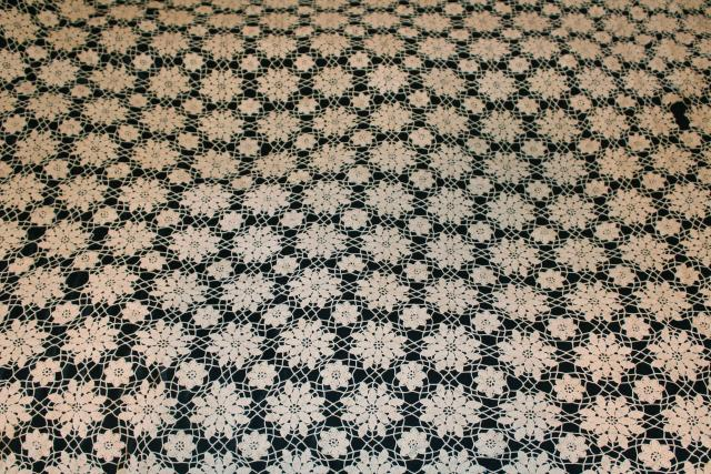 vintage crocheted lace bedspread, lacy crochet flowers or snowflakes