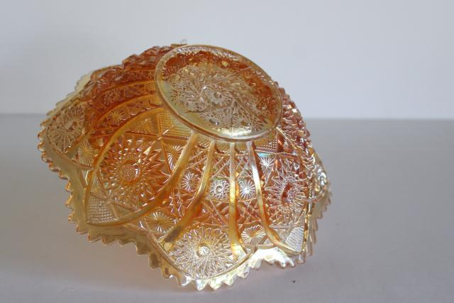 vintage daisy and button pattern glass bowl, marigold orange luster carnival glass